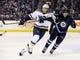 Dec 15, 2015; Winnipeg, Manitoba, CAN;  Winnipeg Jets defenseman Ben Chiarot (7) looks to tie up St. Louis Blues right wing Ryan Reaves (75) during the third period at MTS Centre. St. Louis Blues wins 4-3. Mandatory Credit: Bruce Fedyck-USA TODAY Sports