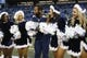 Dec 20, 2015; Seattle, WA, USA; Seattle Seahawks defensive end Michael Bennett (72) poses for a photo with the SeaGals cheerleaders following a 30-13 victory against the Cleveland Browns at CenturyLink Field. Mandatory Credit: Joe Nicholson-USA TODAY Sports