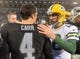 Dec 20, 2015; Oakland, CA, USA; Oakland Raiders quarterback Derek Carr (4) and Green Bay Packers quarterback Aaron Rodgers (12) shake hands after an NFL football game at O.co Coliseum. The Packers defeated the Raiders 30-20. Mandatory Credit: Kirby Lee-USA TODAY Sports