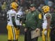 Dec 20, 2015; Oakland, CA, USA; Green Bay Packers head coach Mike McCarthy (center) talks with quarterback Aaron Rodgers (12), quarterback Scott Tolzien (16) and wide receiver Randall Cobb (18) during an NFL football game against the Oakland Raiders at O.co Coliseum. The Packers defeated the Raiders 30-20. Mandatory Credit: Kirby Lee-USA TODAY Sports