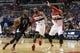 Dec 28, 2015; Washington, DC, USA; Los Angeles Clippers guard Chris Paul (3) dribbles the ball as Washington Wizards guard John Wall (2) and Wizards forward Kelly Oubre Jr. (12) defend in the first quarter at Verizon Center. Mandatory Credit: Geoff Burke-USA TODAY Sports