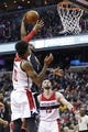 Dec 28, 2015; Washington, DC, USA; Los Angeles Clippers guard Chris Paul (3) dunks the ball as Washington Wizards forward Kelly Oubre Jr. (12) defends in the second quarter at Verizon Center. Mandatory Credit: Geoff Burke-USA TODAY Sports