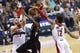Dec 28, 2015; Washington, DC, USA; Washington Wizards forward Kelly Oubre Jr. (12) blocks the shot of Los Angeles Clippers forward Luc Richard Mbah a Moute (12) in the third quarter at Verizon Center. The Clippers won 108-91. Mandatory Credit: Geoff Burke-USA TODAY Sports