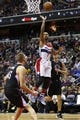 Dec 28, 2015; Washington, DC, USA; Washington Wizards guard Ramon Sessions (7) shoots the ball over Los Angeles Clippers center Cole Aldrich (45) in the third quarter at Verizon Center. The Clippers won 108-91. Mandatory Credit: Geoff Burke-USA TODAY Sports