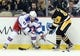Feb 10, 2016; Pittsburgh, PA, USA; New York Rangers defenseman Keith Yandle (93) and Pittsburgh Penguins center Scott Wilson (23) battle for the puck along the boards during the second period at the CONSOL Energy Center. Mandatory Credit: Charles LeClaire-USA TODAY Sports