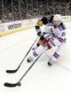 Feb 10, 2016; Pittsburgh, PA, USA; New York Rangers center Oscar Lindberg (24) reaches for the puck ahead of Pittsburgh Penguins defenseman Brian Dumoulin (8) during the third period at the CONSOL Energy Center. The Rangers shutout the Penguins 3-0. Mandatory Credit: Charles LeClaire-USA TODAY Sports