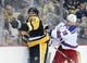 Feb 10, 2016; Pittsburgh, PA, USA; New York Rangers center J.T. Miller (10) checks Pittsburgh Penguins defenseman Derrick Pouliot (51) against the boards during the third period at the CONSOL Energy Center. The Rangers shutout the Penguins 3-0. Mandatory Credit: Charles LeClaire-USA TODAY Sports