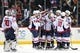 Feb 18, 2016; Brooklyn, NY, USA; Washington Capitals right wing Justin Williams (14) celebrates his game winning goal against the New York Islanders with teammates during the overtime period at Barclays Center. The Capitals defeated the Islanders 3-2 in overtime. Mandatory Credit: Brad Penner-USA TODAY Sports