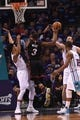 Apr 29, 2016; Charlotte, NC, USA; Miami Heat guard Dwyane Wade (3) moves to the basket and passes the ball off as he is defended by Charlotte hornets guard Courtney Lee (1) and forward center Frank Kaminsky (44) during the first half in game six of the first round of the NBA Playoffs at Time Warner Cable Arena. Mandatory Credit: Sam Sharpe-USA TODAY Sports