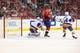 Oct 15, 2016; Washington, DC, USA; Washington Capitals left wing Daniel Winnik (26) scores a goal on New York Islanders goalie Thomas Greiss (1) in the first period at Verizon Center. Mandatory Credit: Geoff Burke-USA TODAY Sports