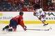 Oct 15, 2016; Washington, DC, USA; New York Islanders center John Tavares (91) passes the puck as Washington Capitals defenseman Karl Alzner (27) defends in the second period at Verizon Center. Mandatory Credit: Geoff Burke-USA TODAY Sports