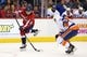 Oct 15, 2016; Washington, DC, USA; Washington Capitals defenseman Nate Schmidt (88) shoots the puck as New York Islanders center Shane Prince (11) defends in the third period at Verizon Center. The Capitals won 2-1. Mandatory Credit: Geoff Burke-USA TODAY Sports