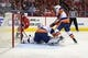 Oct 15, 2016; Washington, DC, USA; New York Islanders goalie Thomas Greiss (1) makes a save on Washington Capitals center Nicklas Backstrom (19) in the third period at Verizon Center. The Capitals won 2-1. Mandatory Credit: Geoff Burke-USA TODAY Sports