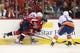 Oct 15, 2016; Washington, DC, USA; Washington Capitals center Lars Eller (20) and New York Islanders center Mathew Barzal (13) battle for the puck in the third period at Verizon Center. The Capitals won 2-1. Mandatory Credit: Geoff Burke-USA TODAY Sports