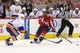Oct 15, 2016; Washington, DC, USA; Washington Capitals center Lars Eller (20) skates with the puck as New York Islanders defenseman Travis Hamonic (3) defends in the third period at Verizon Center. The Capitals won 2-1. Mandatory Credit: Geoff Burke-USA TODAY Sports
