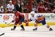 Oct 15, 2016; Washington, DC, USA; Washington Capitals left wing Marcus Johansson (90) skates with the puck past New York Islanders left wing Brock Nelson (29) in the third period at Verizon Center. The Capitals won 2-1. Mandatory Credit: Geoff Burke-USA TODAY Sports