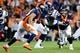 Oct 24, 2016; Denver, CO, USA; Denver Broncos quarterback Trevor Siemian (13) pitches the ball to running back Devontae Booker (23) in the fourth quarter against the Houston Texans at Sports Authority Field at Mile High. The Broncos won 27-9. Mandatory Credit: Isaiah J. Downing-USA TODAY Sports