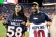 Oct 24, 2016; Denver, CO, USA; Houston Texans wide receiver DeAndre Hopkins (left) and Denver Broncos outside linebacker Von Miller (right) swap jerseys after the game at Sports Authority Field at Mile High. The Broncos won 27-9. Mandatory Credit: Isaiah J. Downing-USA TODAY Sports