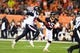 Oct 24, 2016; Denver, CO, USA; Denver Broncos cornerback Chris Harris (25) defends an reception attempt by Houston Texans wide receiver DeAndre Hopkins (10) in the second half at Sports Authority Field at Mile High. The Broncos defeated the Texans 27-9. Mandatory Credit: Ron Chenoy-USA TODAY Sports