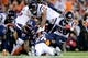 Oct 24, 2016; Denver, CO, USA; Houston Texans running back Alfred Blue (28) is tackled by Denver Broncos free safety Darian Stewart (26) and defensive tackle Billy Winn (97) in the fourth quarter at Sports Authority Field at Mile High. The Broncos won 27-9. Mandatory Credit: Isaiah J. Downing-USA TODAY Sports
