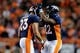 Oct 24, 2016; Denver, CO, USA; Denver Broncos running back Devontae Booker (23) celebrates with running back C.J. Anderson (22) after scoring a touchdown in the fourth quarter against the Houston Texans at Sports Authority Field at Mile High. The Broncos won 27-9. Mandatory Credit: Isaiah J. Downing-USA TODAY Sports