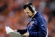 Oct 24, 2016; Denver, CO, USA; Denver Broncos head coach Gary Kubiak looks at his play card in the fourth quarter against the Houston Texans at Sports Authority Field at Mile High. The Broncos won 27-9. Mandatory Credit: Isaiah J. Downing-USA TODAY Sports