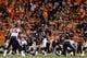 Oct 24, 2016; Denver, CO, USA; Denver Broncos quarterback Trevor Siemian (13) makes a call behind center Matt Paradis (61) as Houston Texans inside linebacker Benardrick McKinney (55) looks on in the third quarter at Sports Authority Field at Mile High. Mandatory Credit: Isaiah J. Downing-USA TODAY Sports