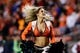 Oct 24, 2016; Denver, CO, USA; A Denver Broncos cheerleader performs in the fourth quarter against the Houston Texans at Sports Authority Field at Mile High. Mandatory Credit: Isaiah J. Downing-USA TODAY Sports