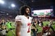 Nov 13, 2016; Glendale, AZ, USA; San Francisco 49ers quarterback Colin Kaepernick (7) leaves the field after the second half against the Arizona Cardinals at University of Phoenix Stadium. The Cardinals won 23-20. Mandatory Credit: Joe Camporeale-USA TODAY Sports
