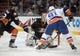 November 22, 2016; Anaheim, CA, USA;  Anaheim Ducks defenseman Josh Manson (42) helps goalie Jonathan Bernier (1) defend the goal against New York Islanders center John Tavares (91) during the first period at Honda Center. Mandatory Credit: Gary A. Vasquez-USA TODAY Sports