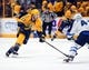Nov 25, 2016; Nashville, TN, USA; Nashville Predators left wing Colin Wilson (33) skates with the puck across the blue line during the first period against the Winnipeg Jets at Bridgestone Arena. Mandatory Credit: Christopher Hanewinckel-USA TODAY Sports