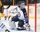 Nov 25, 2016; Nashville, TN, USA; Winnipeg Jets goalie Connor Hellebuyck (37) makes a save during the first period against the Nashville Predators at Bridgestone Arena. Mandatory Credit: Christopher Hanewinckel-USA TODAY Sports