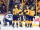 Nov 25, 2016; Nashville, TN, USA; Nashville Predators players celebrate after a goal by left wing Colin Wilson (33) during the second period against the Winnipeg Jets at Bridgestone Arena. Mandatory Credit: Christopher Hanewinckel-USA TODAY Sports