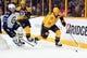 Nov 25, 2016; Nashville, TN, USA; Nashville Predators center Calle Jarnkrok (19) skates with the puck during the second period against the Winnipeg Jets at Bridgestone Arena. The Predators won 5-1. Mandatory Credit: Christopher Hanewinckel-USA TODAY Sports