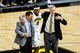 Dec 5, 2016; Iowa City, IA, USA; Injured Iowa Hawkeyes forward Ahmad Wagner (0) is assisted by the Iowa trainer (left) and head coach Fran McCaffery (right) during the second half against the Stetson Hatters at Carver-Hawkeye Arena. Mandatory Credit: Jeffrey Becker-USA TODAY Sports
