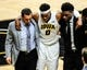 Dec 5, 2016; Iowa City, IA, USA; Injured Iowa Hawkeyes forward Ahmad Wagner (0) is assisted by the Iowa trainer (left) and forward Tyler Cook (right) during the second half against the Stetson Hatters at Carver-Hawkeye Arena. Mandatory Credit: Jeffrey Becker-USA TODAY Sports