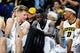 Dec 5, 2016; Iowa City, IA, USA; Iowa Hawkeyes guard Brady Ellingson (left) and guard Peter Jok (middle) and forward Ahmad Wagner (right) talk on the bench during the second half against the Stetson Hatters at Carver-Hawkeye Arena. Iowa won 95-68. Mandatory Credit: Jeffrey Becker-USA TODAY Sports