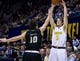 Dec 17, 2016; Berkeley, CA, USA;  California Golden Bears guard Grant Mullins (3) takes a three-point shot as Cal Poly Mustangs guard Ridge Shipley (10) defends in the first period at Haas Pavilion. Mandatory Credit: John Hefti-USA TODAY Sports