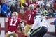 January 1, 2017; Santa Clara, CA, USA; San Francisco 49ers quarterback Colin Kaepernick (7) passes the football in front of Seattle Seahawks defensive tackle Ahtyba Rubin (77) during the first quarter at Levi's Stadium. Mandatory Credit: Kyle Terada-USA TODAY Sports