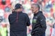 January 1, 2017; Santa Clara, CA, USA; Seattle Seahawks head coach Pete Carroll (right) talks to San Francisco 49ers head coach Chip Kelly (left) before the game at Levi's Stadium. The Seahawks defeated the 49ers 25-23. Mandatory Credit: Kyle Terada-USA TODAY Sports