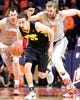 Jan 25, 2017; Champaign, IL, USA; Iowa Hawkeyes forward Ryan Kriener (15) brings the ball up the court pursued by Illinois Fighting Illini center Maverick Morgan (22) and forward Michael Finke (43) during the second half at State Farm Center. Illinois beat Iowa 76 to 64.  Mandatory Credit: Mike Granse-USA TODAY Sports