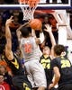 Jan 25, 2017; Champaign, IL, USA; Illinois Fighting Illini forward Leron Black (12) attempts a shot defended by Iowa Hawkeyes guard Brady Ellingson (24) and forward Ahmad Wagner (0) during the second half at State Farm Center. Illinois beat Iowa 76 to 64.  Mandatory Credit: Mike Granse-USA TODAY Sports