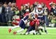 Feb 5, 2017; Houston, TX, USA; Atlanta Falcons wide receiver Mohamed Sanu (12) is tackled by members of the New England Patriots in the fourth quarter during Super Bowl LI at NRG Stadium. Mandatory Credit: Mark J. Rebilas-USA TODAY Sports