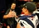 Feb 5, 2017; Houston, TX, USA; New England Patriots quarterback Tom Brady celebrates in the locker room with wide receiver Chris Hogan (15) after defeating the Atlanta Falcons during Super Bowl LI at NRG Stadium. Mandatory Credit: Mark J. Rebilas-USA TODAY Sports