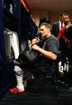 Feb 5, 2017; Houston, TX, USA; New England Patriots quarterback Tom Brady (12) reacts as he looks through his bag for his missing jersey in the locker room after defeating the Atlanta Falcons during Super Bowl LI at NRG Stadium. Mandatory Credit: Mark J. Rebilas-USA TODAY Sports