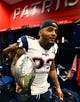 Feb 5, 2017; Houston, TX, USA; New England Patriots safety Patrick Chung (23) celebrates in the locker room with the Vince Lombardi trophy after defeating the Atlanta Falcons during Super Bowl LI at NRG Stadium. Mandatory Credit: Mark J. Rebilas-USA TODAY Sports