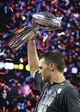 Feb 5, 2017; Houston, TX, USA; New England Patriots quarterback Tom Brady (12) celebrates with the Vince Lombardi Trophy after beating the Atlanta Falcons during Super Bowl LI at NRG Stadium. Mandatory Credit: Matthew Emmons-USA TODAY Sports