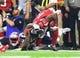 Feb 5, 2017; Houston, TX, USA; Atlanta Falcons wide receiver Mohamed Sanu (12) is tackled by New England Patriots cornerback Logan Ryan (26) as he loses his helmet in the fourth quarter during Super Bowl LI at NRG Stadium.Mandatory Credit: Mark J. Rebilas-USA TODAY Sports