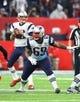 Feb 5, 2017; Houston, TX, USA; New England Patriots offensive guard Shaq Mason (69) blocks for quarterback Tom Brady (12) against the Atlanta Falcons during Super Bowl LI at NRG Stadium. Mandatory Credit: Mark J. Rebilas-USA TODAY Sports
