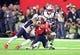 Feb 5, 2017; Houston, TX, USA; New England Patriots safety Patrick Chung (23) tackles Atlanta Falcons wide receiver Mohamed Sanu (12) during Super Bowl LI at NRG Stadium. Mandatory Credit: Mark J. Rebilas-USA TODAY Sports